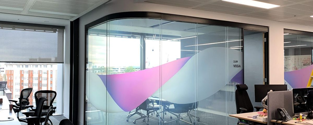 Finastra Office Space with Curved Glass Smart Film